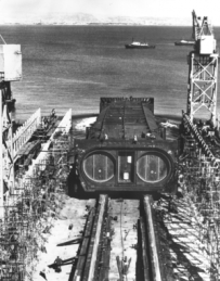 A segment of the transbay tube is lowered into the Bay (courtesy of bart.gov).