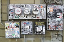 Utility boxes covered with the work of graffiti writers. (Jeremy Raff/KQED)