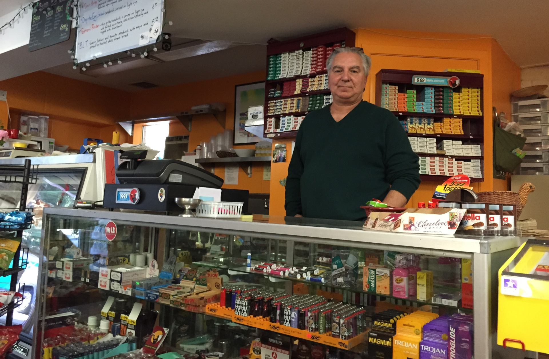 Dean Nicolaides stands at the counter of Dino's Loch Lomond Market on Sept. 29, 2015. The store had yet to reopen following the Valley Fire that destroyed Nicolaides' home along with about 1,300 others.