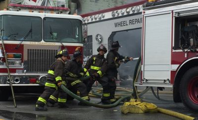 San Francisco firefighters battle a three-alarm fire at a tire shop in the city's Mission District on Nov. 8.