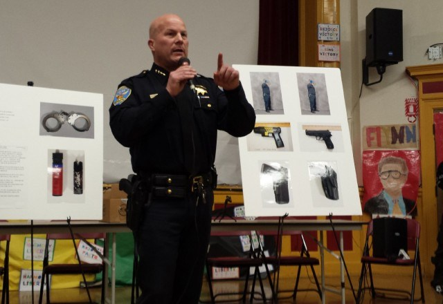 San Francisco Police Chief Greg Suhr addresses an angry crowd at a town hall meeting four days after police fatally shot Alejandro Nieto.