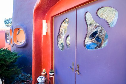 The front door of the Flintstone House, as well several other windows, are decorated with artistic stained glass.