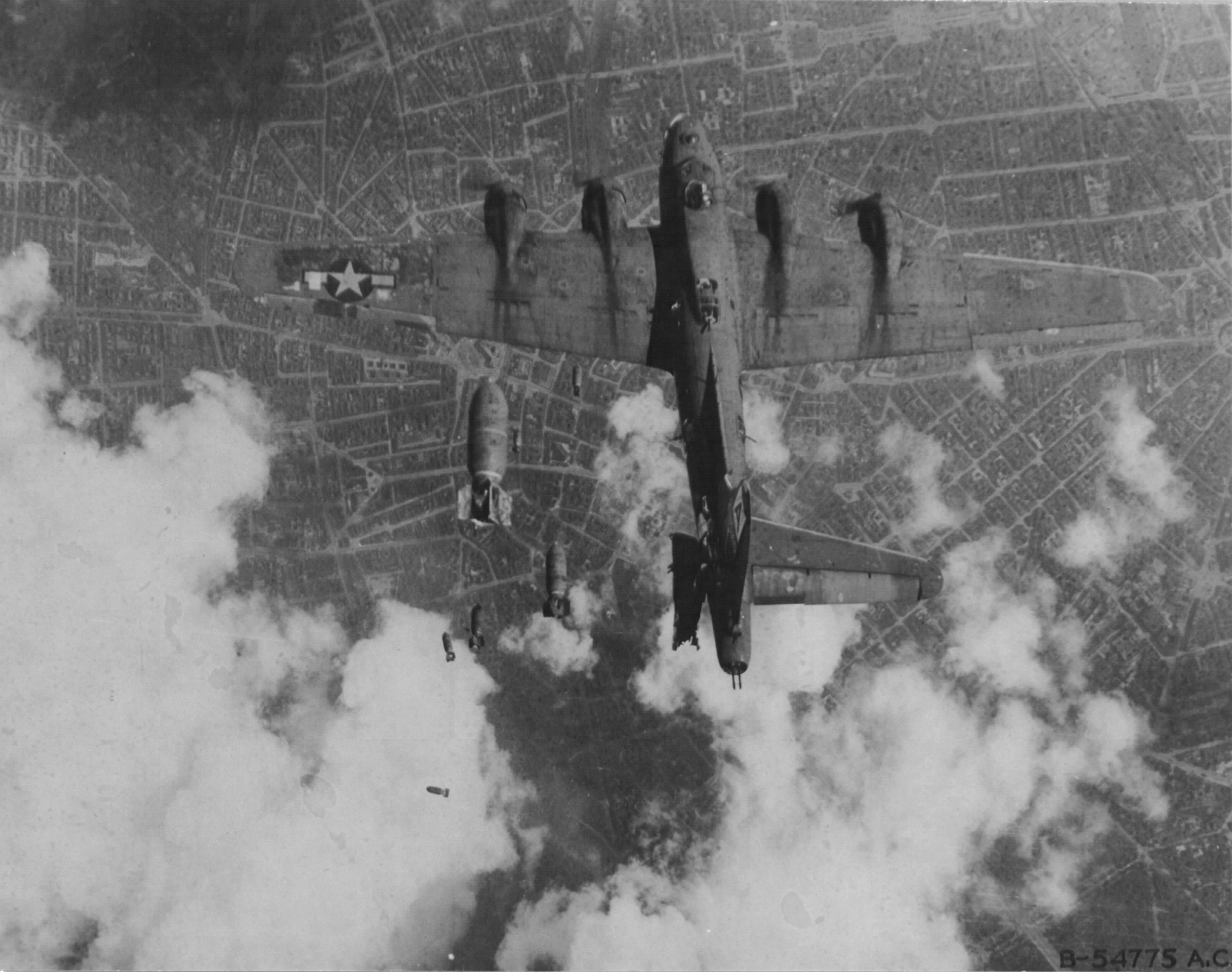 B-17G Fortress 'Miss Donna Mae II' drifted under another bomber on a bomb run over Berlin, 19 May 1944. A 1,000 lb bomb from above tore off the left stabilizer and sent the plane into an uncontrollable spin. All 11 were killed. Photo 3 of 4