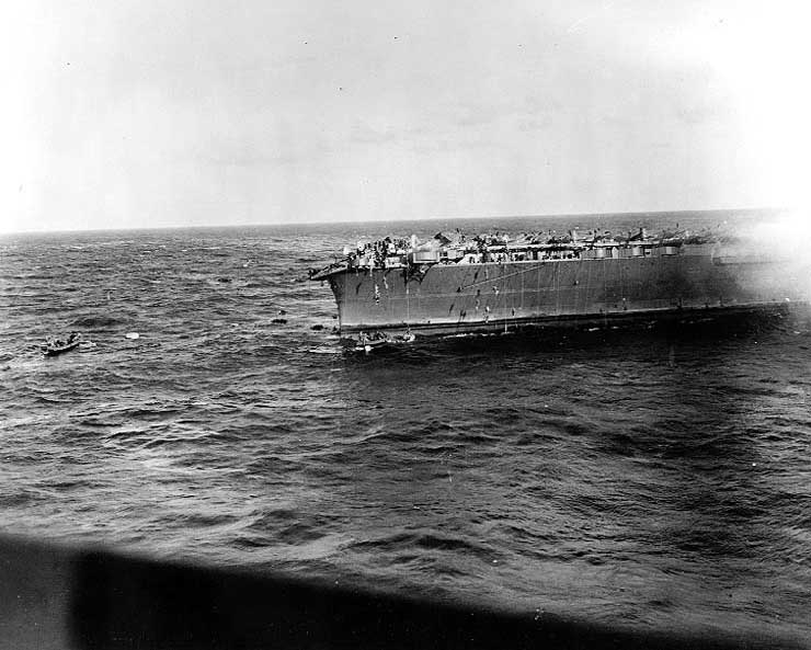 A whaleboat and a motor launch evacuated Lexington, 8 May 1942; TBD, SBD and F4F aircraft could be seen on the flight deck