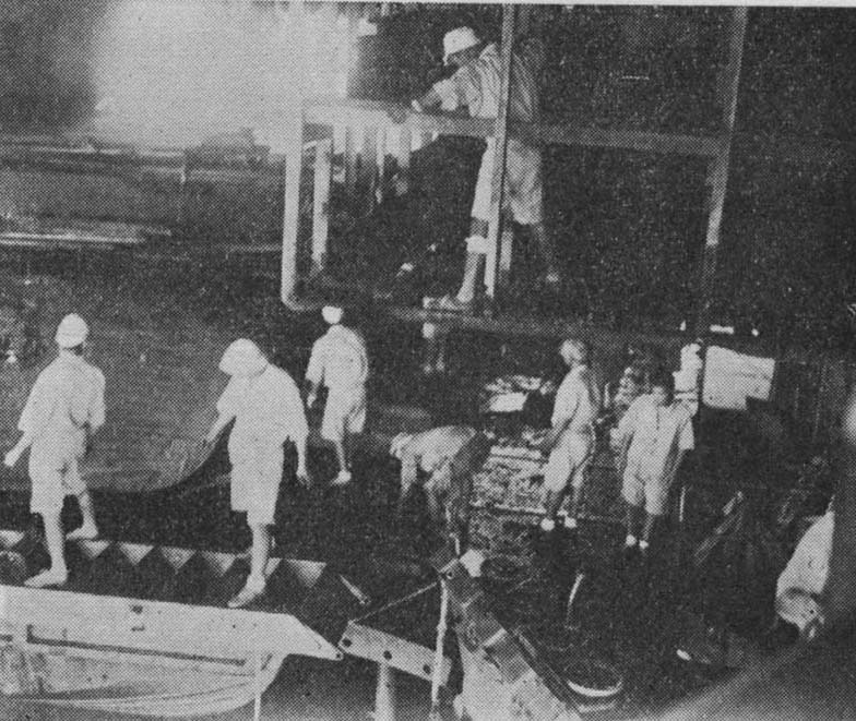 Repair activities aboard Shokaku's boat deck, damaged by the second bomb that hit her during the Battle of Coral Sea, Kure, Japan, between 17 May and 27 Jun 1942