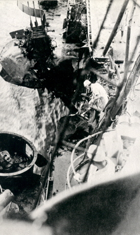Repairing a machine gun position aboard Shokaku, which was damaged by the third bomb hit during Battle of the Coral Sea, , Kure, Japan, between 17 May and 27 Jun 1942