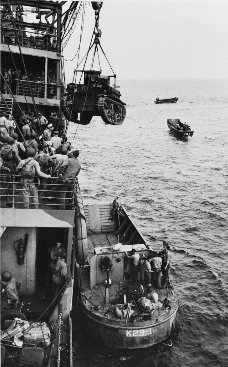 USS Alchiba unloading an US Marine Corps M2A4 light tank into a LCM(2) landing craft, Guadalcanal, 7 Aug 1942