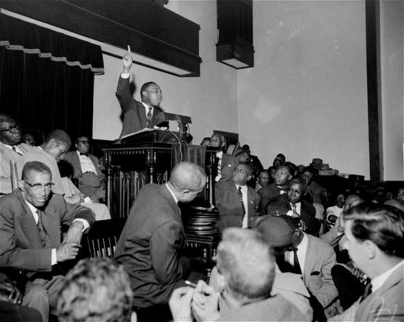 """The Rev. Martin Luther King, Jr. is shown speaking to an overflow crowd at a mass meeting at the Holt Street Baptist Church.  King, leader of the mass bus boycott, was found guilty March 22, 1956 of conspiracy in the Montgomery bus boycott. He was fined $500.  King said the boycott of city buses will continue """"no matter how many times they convict me.""""   (AP Photo/Gene Herrick) Photo: GENE HERRICK, STF / Beaumont"""