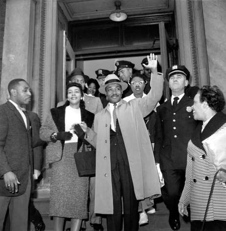 The Rev. Dr. Martin Luther King Jr., of Alabama, waves to the nearly 500 people waiting outside Harlem hospital in New York City on Oct. 3, 1958.  Dr. King was stabbed on Sept. 20.  (AP Photo) / Beaumont