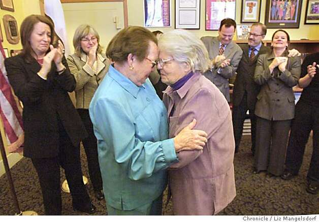 Phyllis Lyon, 79, left, and Del Martin, 83, right, who have been together for 51 years, say their vows