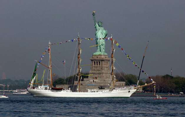 The Buque Escuela Arm Cuauhtemoc, from Mexico, sails by the Statue Of Liberty, in New York, to participate in Fleet Week activities, Wednesday. This year's event marks the bicentennial of the War of 1812. (AP Photo/Richard Drew) Photo: Associated Press / SL