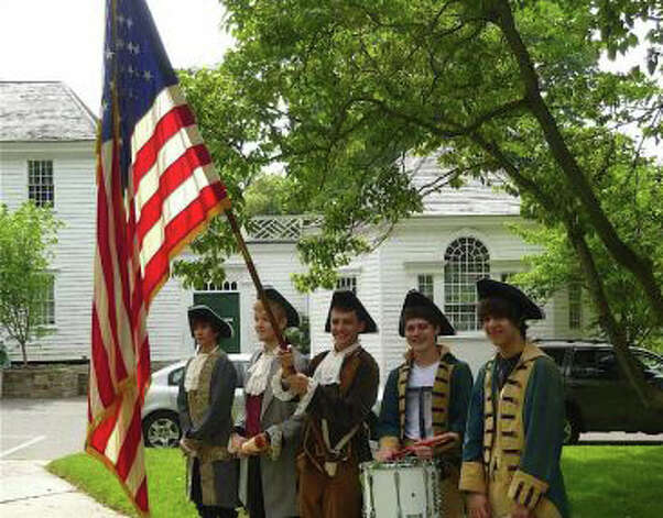 Fairfield's annual Town Hall Green ceremonies marking Independence Day next Wednesday, July 4, will feature a traditional salute to the Declaration of Independence and special recognition of the bicentennial of the War of 1812. Here, a color guard from last year's July 4 ceremony attired in Revolutionary-era uniforms. Photo: File Photo / Fairfield Citizen