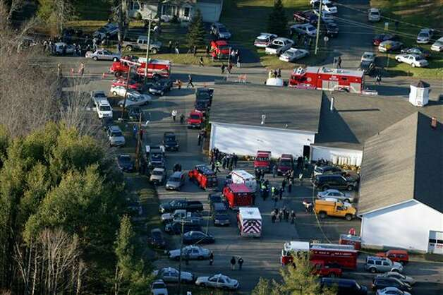 This aerial photo shows a triage area set up at the Sandy Hook fire station in Newtown, Conn., near where authorities say a gunman opened fire inside Sandy Hook Elementary School in a shooting that left 27 people dead, including 18 children, Friday, Dec. 14, 2012.