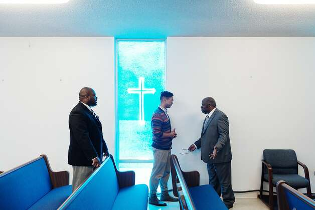 Pastor George Gaskin (right), whose mother died of colon cancer, greets parishioners at Bethel Baptist Church in Union City. Photo: Peter Earl McCollough, Special To The Chronicle