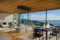 Retractable glass walls create exemplary indoor/outdoor ...