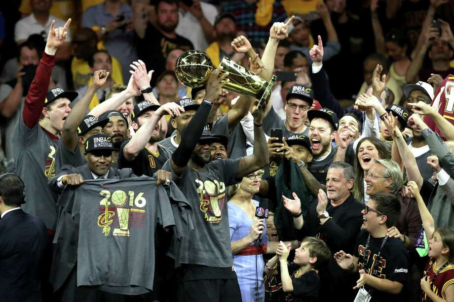 OAKLAND, CA - JUNE 19:  LeBron James #23 of the Cleveland Cavaliers holds the Larry O'Brien Championship Trophy after defeating the Golden State Warriors 93-89 in Game 7 of the 2016 NBA Finals at ORACLE Arena on June 19, 2016 in Oakland, California. NOTE TO USER: User expressly acknowledges and agrees that, by downloading and or using this photograph, User is consenting to the terms and conditions of the Getty Images License Agreement. Photo: Ronald Martinez, Getty Images / 2016 Getty Images