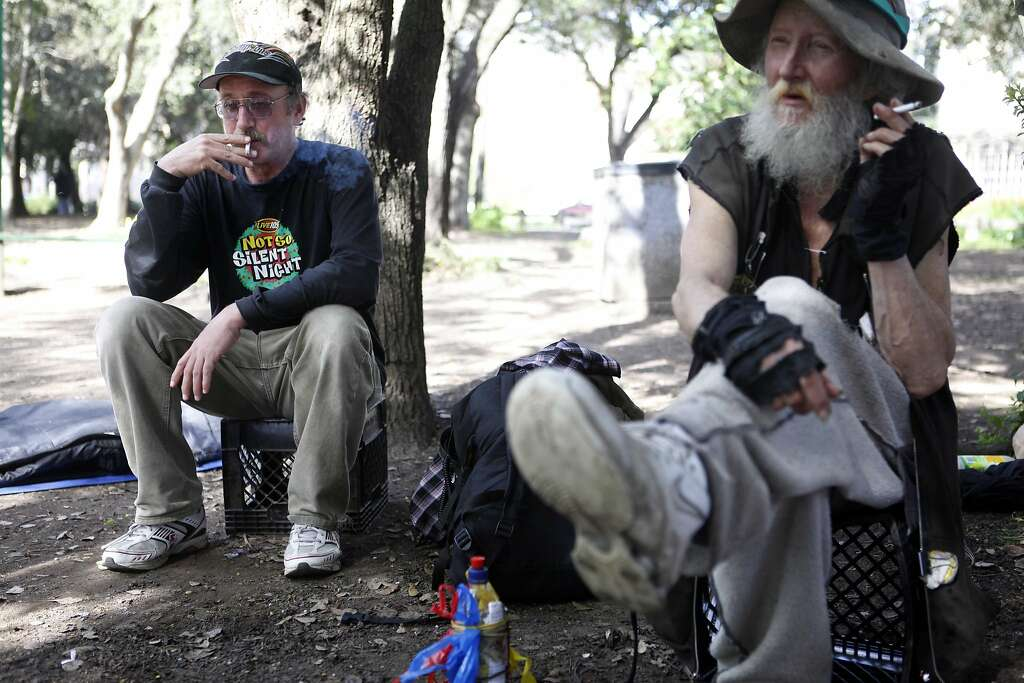 "Mark ""Hate Man"" Hawthorne, right, and his friend Ace Backwords in People's Park in Berkeley on March 17, 2010. Photo: Mike Kepka, The Chronicle"