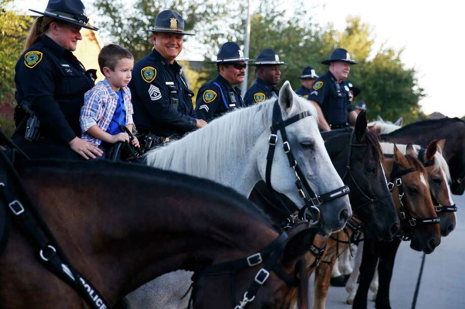 Kevin Will Jr., 5, the son of slain Houston police officer Kevin Will, sits on top of a horse as he is escorted to his first day of school by Houston police and other officers Tuesday, Aug. 22, 2017 in Cypress. Kevin Will was killed in May 2011, just months before Kevin Will Jr. was born, when a drunken driver hit Will as he investigated a traffic crash. Photo: Michael Ciaglo, Houston Chronicle / Michael Ciaglo