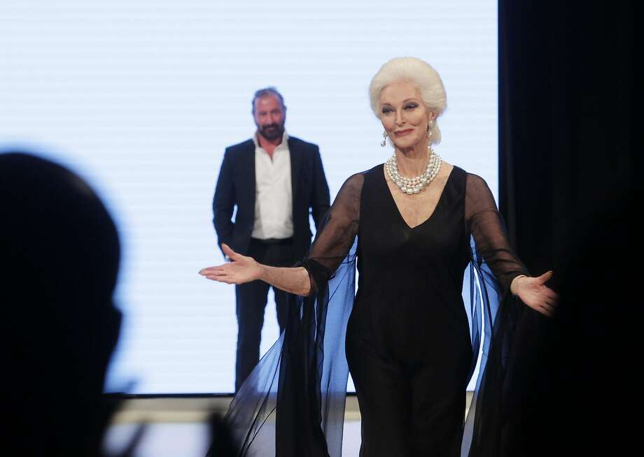Carmen Dell'Orefice reacts as Ralph Rucci presents her with the Texas Legacy award at Heart of Fashion, at Million Air Houston. Dell'Orefice notably closed the Guo Pei haute couture show in Paris in January 2017 at age 85. Photo: Jon Shapley, Houston Chronicle