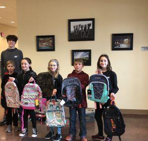 Western Wayne senior Damian Johnson donates book bags