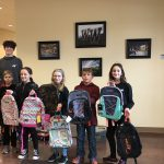 Western Wayne senior Damian Johnson donates book bags