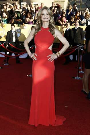 Kyra Sedgwick arrives at the 18th Annual Screen Actors Guild Awards on Sunday Jan. 29, 2012 in Los Angeles. (AP Photo/Matt Sayles) Photo: Matt Sayles, Associated Press / SF