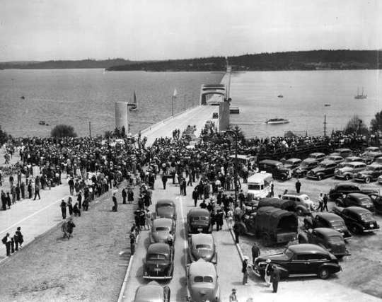 """Original Lake Washington floating bridge: Opened on July 3, 1940, this was the concrete bridge that started them all in Washington state. The state's highway chief, Lacey V. Murrow, endorsed a concrete floating bridge despite intense skepticism. As former WSDOT chief bridge engineer Charles Gloyd wrote about the bridge's debut in a 1988 article, """"certain wags wore life jackets to show their lack of faith."""""""