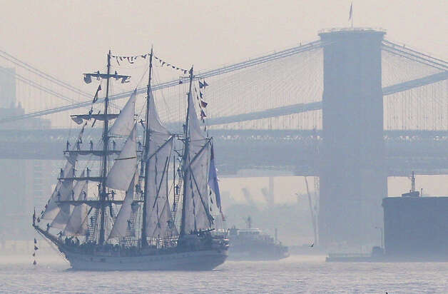 Tall ships travel up the Hudson River past New York City bridges as seen from Bayonne, N.J., Wednesday. Naval vessels ranging from a U.S. amphibious assault ship to a Finnish minelayer are participating in New York City's Fleet Week. (AP Photo/Seth Wenig) Photo: Associated Press / SL