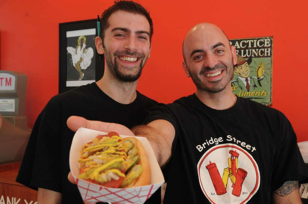 Co-owners Steve Sabia, left, and Mike Palmer, right, pose for a photo at their restaurant, Bridge Street Wienery, in Stamford on Wednesday, July 18, 2012. Photo: Lindsay Niegelberg / Stamford Advocate