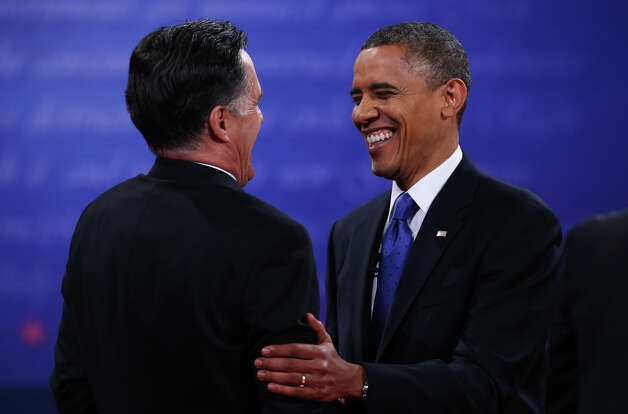 BOCA RATON, FL - OCTOBER 22:  U.S. President Barack Obama (R) shakes hands with Republican presidential candidate Mitt Romney after the debate at the Keith C. and Elaine Johnson Wold Performing Arts Center at Lynn University on October 22, 2012 in Boca Raton, Florida. The focus for the final presidential debate before Election Day on November 6 is foreign policy.  (Photo by Mark Wilson/Getty Images) Photo: Mark Wilson, Getty Images / 2012 Getty Images