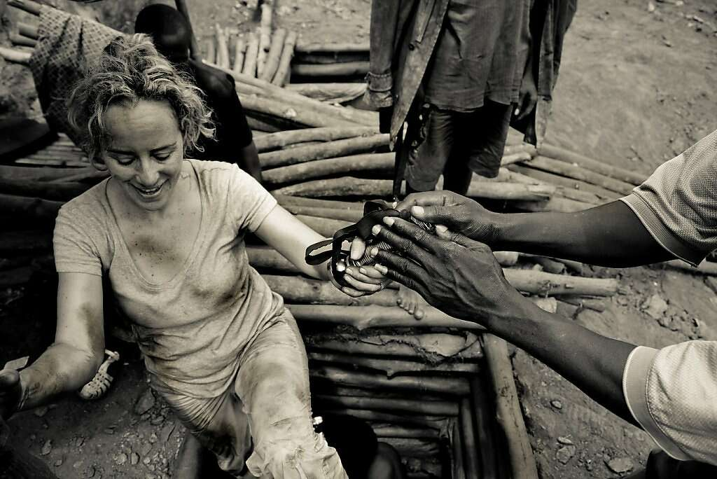 Humanitarian photographer Lisa Kristine emerges from an illegal gold mine in Ghana after photographing the enslaved miners who work inside. Photo: Lisa Kristine, Lisa Kristine Photography