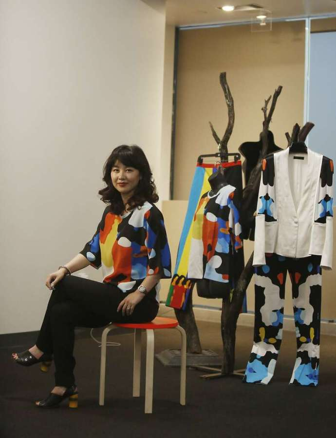 """Simple Pair designer Jessie Liu poses with some of her designs in the new """"white box"""" space at Bespoke in Westfield San Francisco Centre. Photo: Lea Suzuki, The Chronicle"""