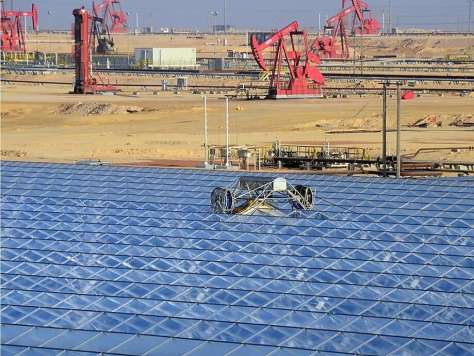 GlassPoint Solar's pilot plant in Oman. The company uses solar power to generate steam, which is then pumped into oil fields to squeeze out more petroleum. Photo: GlassPoint Solar Photo: GlassPoint Solar