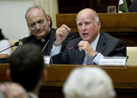 California Gov. Jerry Brown, right,  delivers his speech flanked by the head of the pontifical academy of Science, Bishop Marcelo Sanchez Sorondo, during  a conference on Modern Slavery and Climate Change in the Casina Pio IV the Vatican, Wednesday, July 22, 2015.  Dozens of environmentally friendly mayors from around the world are meeting at the Vatican this week to bask in the star power of eco-Pope Francis and commit to reducing global warming and helping the urban poor deal with its effects. (AP Photo/Alessandra Tarantino) Photo: Alessandra Tarantino, Associated Press