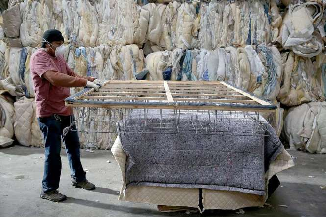 Employees Nery Garcia Works On Separating Materials From A Mattress At Oakland S Dr3 Recycling Center