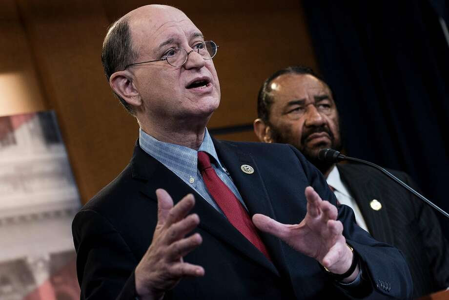 US Representative Brad Sherman (L), Democrat of California,  and US Representative Al Green, Democrat of Texas. Green submitted articles of impeachment against Trump Wednesday in the first legislative step for any congressional bid to remove the president from office. >>Keep clicking for things you need to know about Al Green. Photo: BRENDAN SMIALOWSKI, AFP/Getty Images