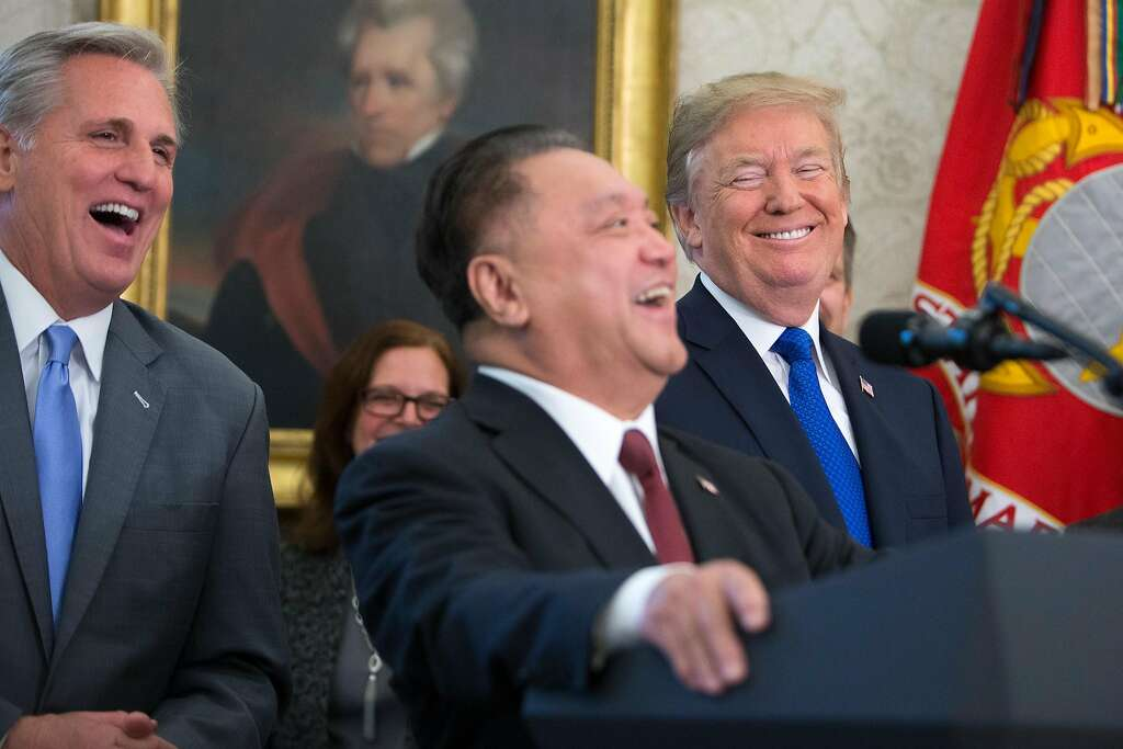 On the same day that Republican lawmakers unveiled their plan for a sweeping rewrite of the tax code, President Donald Trump and House Majority Leader Kevin McCarthy, left, laugh along with Hock Tan, chief executive of Singapore-based Broadcom, during a news conference to announce his company is moving its global headquarters to the U.S., on Capitol Hill in Washington, Nov. 2, 2017. (R-Calif.). (Tom Brenner/The New York Times) Photo: TOM BRENNER, NYT