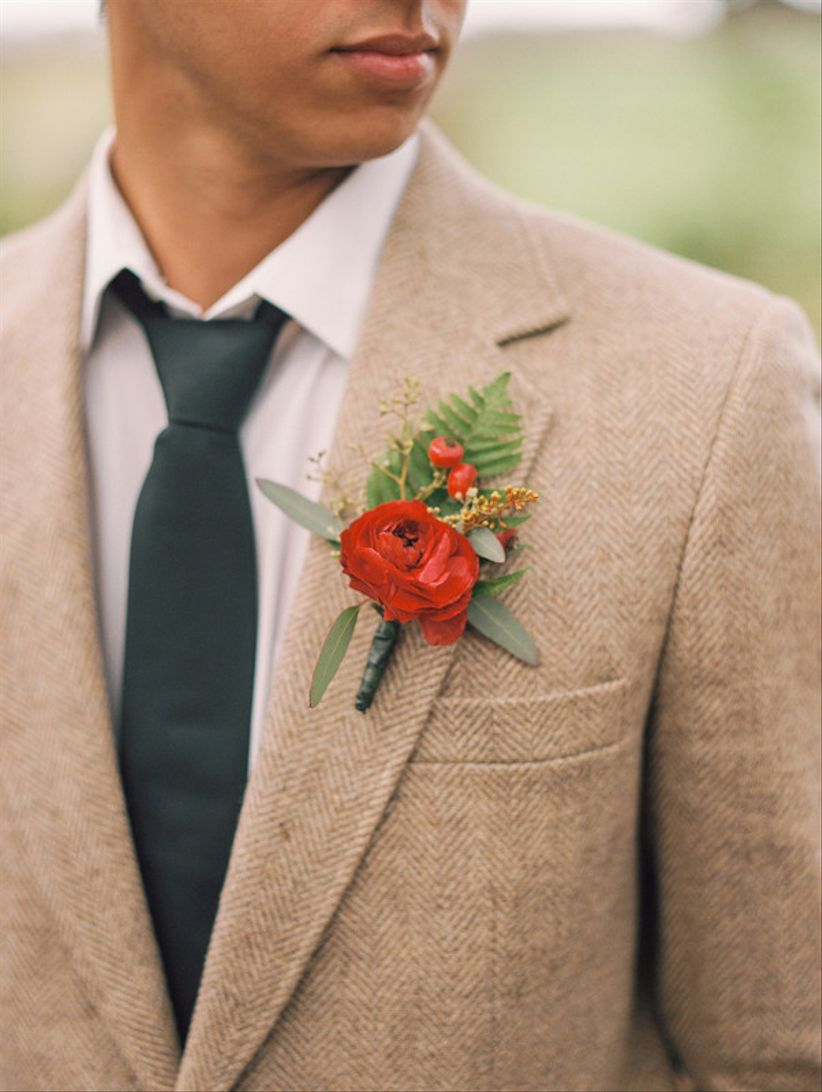 tweed groom suit with red ranunculus boutonniere