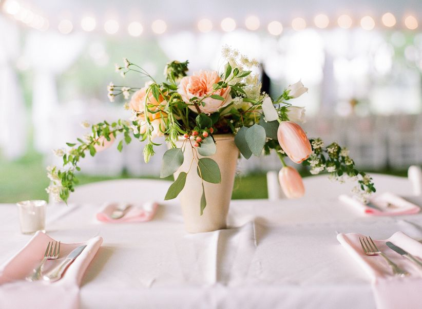 spring wedding centerpiece with pink tulips,... </p data-recalc-dims=