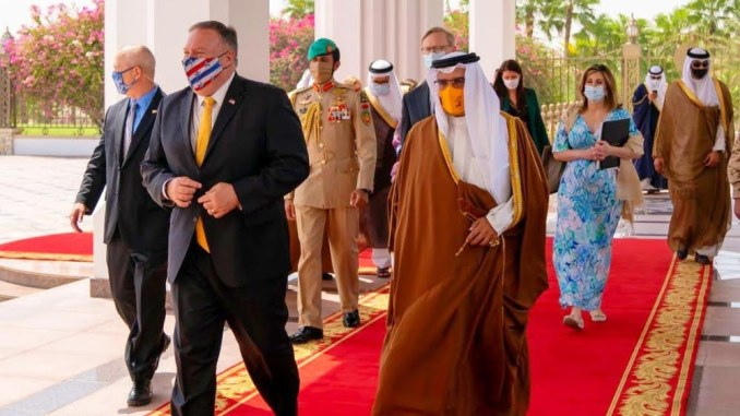 A handout picture released by Bahrain's official news agency (BNA) on August 26, 2020, US Secretary of State Mike Pompeo (C-L) meeting with Bahrain's Crown Prince Salman bin Hamad bin Isa al-Khalifa (