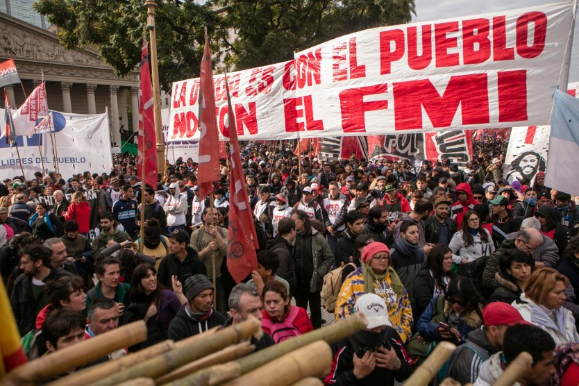 Protesters show a sign that reads 'The debt is with the people, not the IMF' during a demonstration at Plaza de Mayo on August 15, 2019, in Buenos Aires, Argentina [Ricardo Ceppi/ Getty Images]