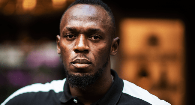 """In this file photo Jamaican Olympic sprinter Usain Bolt poses during a photo session as he launches a new brand of electric scooters named """"Bolt"""" in Paris, on May 15, 2019. Martin BUREAU / AFP"""