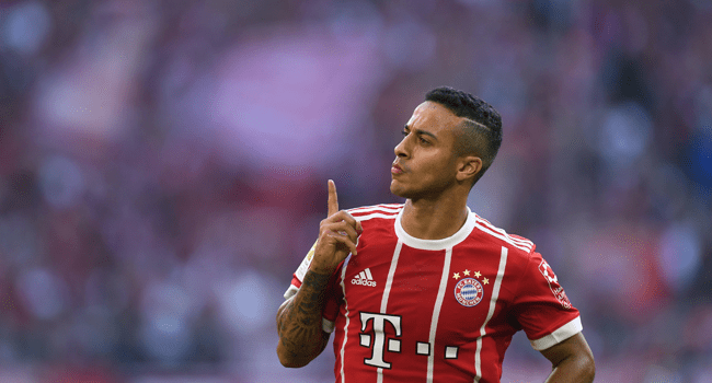 In this file photo taken on October 14, 2017 Bayern Munich's Spanish midfielder Thiago Alcantara celebrates after scoring the 3-0 during the German First division Bundesliga football match FC Bayern Munich vs SC Freiburg in Munich, southern Germany. Liverpool announced the signing of Thiago Alcantara from Bayern Munich on Friday, September 18. Christof STACHE / AFP