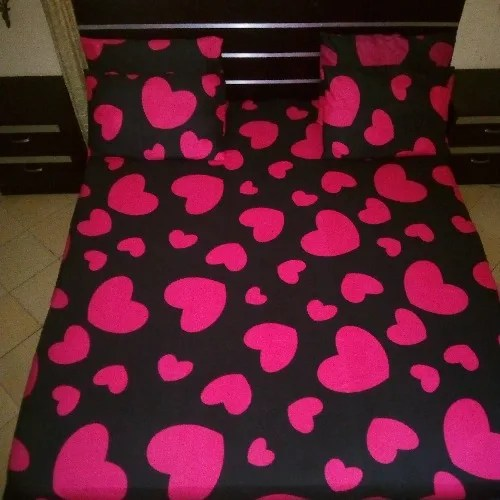 black and pink bedsheet