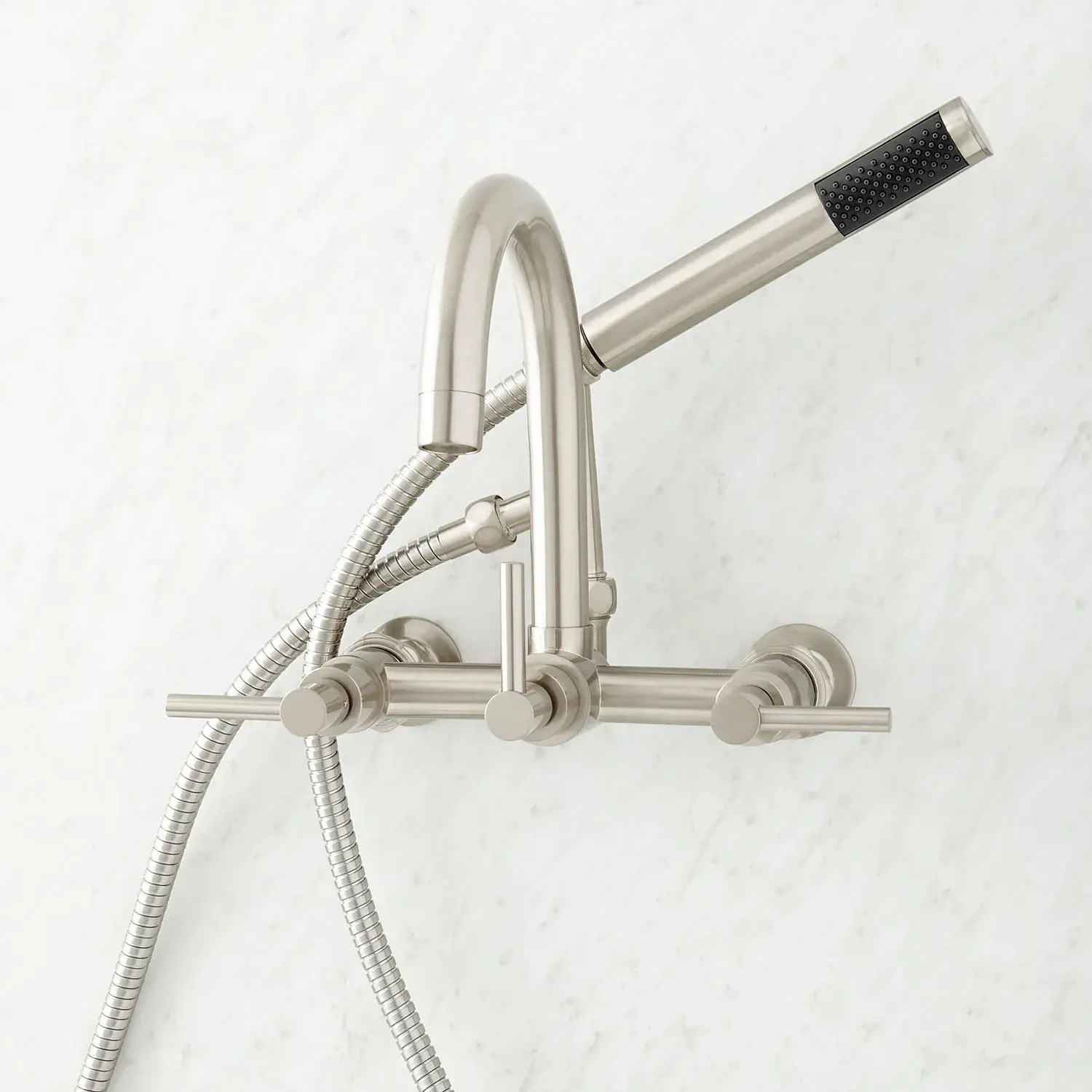 sebastian wall mount tub faucet with lever handles and wall couplers