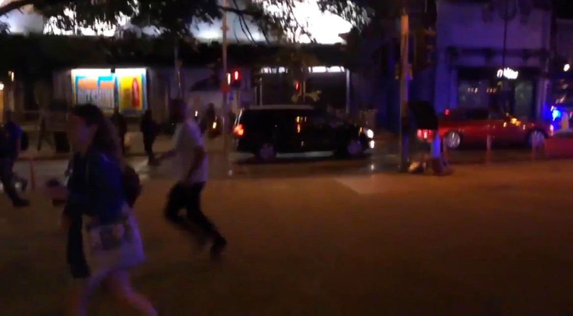 Desperate bystanders are pictured running from the scene