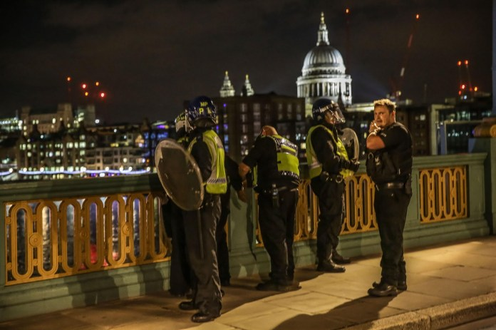 Another suspect being arrested on Southwark Bridge by cops