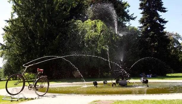 Reclaimed Bike Used As A Fountain In A Public Art