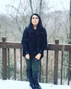 Jackie Lozano standing outside in snow.