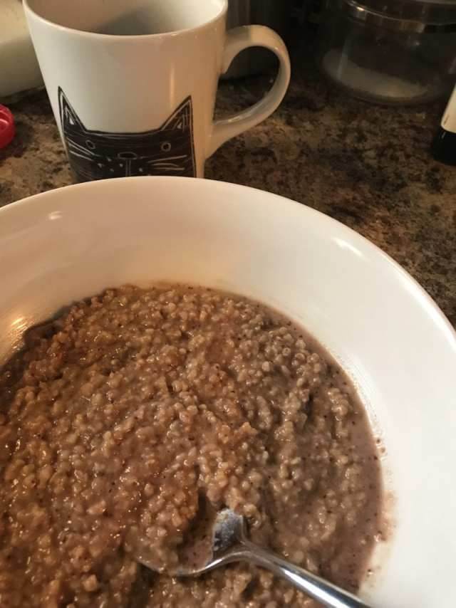 """Steel cut oats with cherry """"pesto"""" made from frozen cherries, roasted hazelnuts, coconut sugar, cinnamon, and lemon juice"""